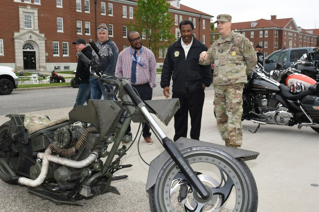 Command Sgt. Maj. Steven Laick, Fort Knox Safety Director Joe Colson and Human Resources Command Safety Manager, Fred Shaw view the Army-themed motorcycle, which was built and donated by Orange County Choppers.