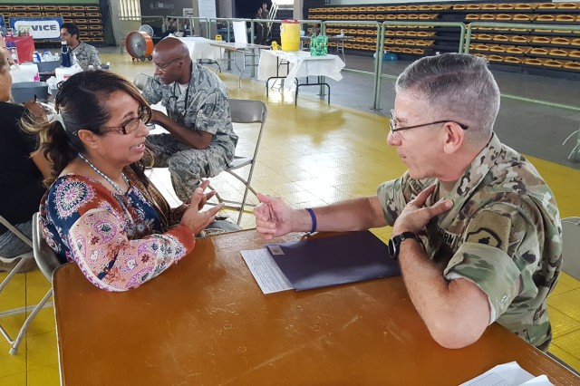 Col. Francisco J. Perez Rivera, a medical provider from the 49th Multifunctional Medical Battalion, U.S. Army Reserve-Puerto Rico, talks with patient Lydia Torres, at the Innovative Readiness Training site in Yauco, May 3.