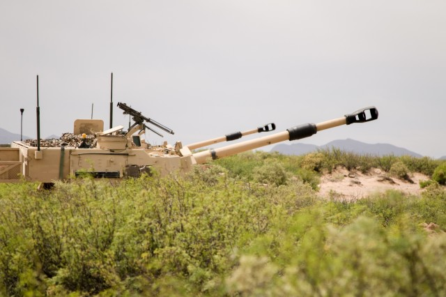 Two M109A6 Paladin howitzer self-propelled guns assigned to the 4th Battalion, 27th Field Artillery Regiment, 2nd Armored Brigade Combat Team, 1st Armored Division, line up their barrels towards a potential training target during a Table XVIII gunnery qualification at Dona Ana Range Complex, N.M., May 7.  The Iron Soldiers of the 2nd ABCT have been training since December in order to maximize their combat capabilities in preparation for two collective training exercises: Iron Focus 19.1 in June and a rotation to the National Training Center later this year.