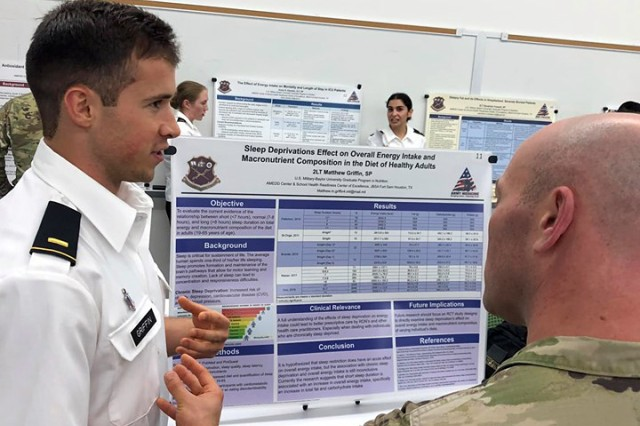 2LT Matthew Griffin, U.S. Military-Baylor Graduate Program in Nutrition, discusses his research findings regarding the effects of sleep restriction on dietary intake. Photo courtesy CPT Paul Rosbrook. HRCoE.