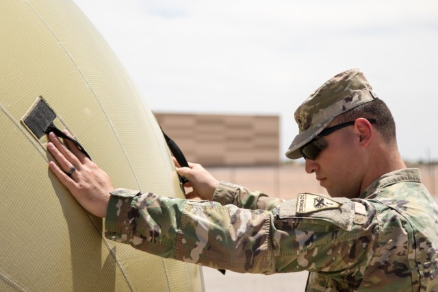 Communications in Motion: Iron Soldiers train on inflatable satellite communications system