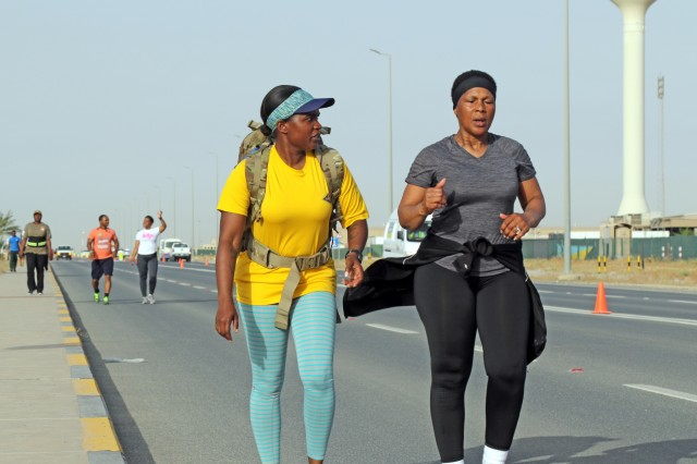 Capt. Toloria Carroll and Master Sgt. Rose Brooks walk during the Asian American Pacific Island Heritage Month 5K at Camp Arifjan, Kuwait, May 11, 2019.(U.S. Army National Guard photo by Sgt. Connie Jones)