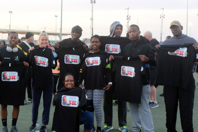Soldiers of 184th Sustainment Command hold up their shirts after completing the Dr. Martin Luther King, Jr. 5K run at Camp Arifjan, Kuwait, Jan. 21, 2019. (U.S. Army National Guard photo by Sgt. Connie Jones)
