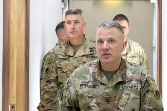 Col. Douglas Ottenberg, director of 398th Financial Management Support Center leads Maj. Gen. Bradley Dreyer,  deputy chief of staff, G8, during a visit at Camp Arifjan, Kuwait, Mar. 16, 2019. (U.S. Army National Guard photo by Sgt. Connie Jones)