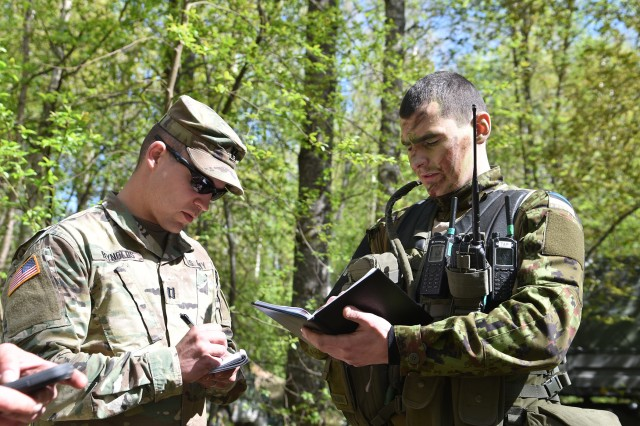Army Capt. Timothy Reynolds, commander of the 290th Military Police Company, Maryland National Guard, speaks with First Lt. Mart Sildnik, company commander of 1st Infantry Brigade military police, Estonian Defense Force, during the Spring Storm exercise, May 6, 2019, in Ida-Viru County, Estonia. Spring Storm is an Estonian Defense Force annual exercise that fosters collaboration between Estonia, the United States, Poland, Britain, Canada, and other participating allied nations.