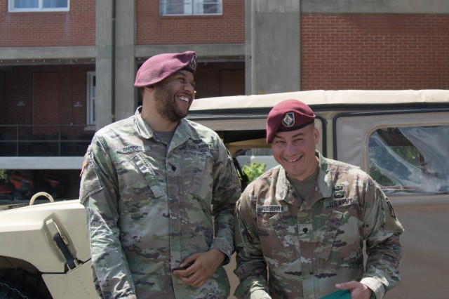 Spc. Jonathan M. Figueroa (right) and Spc. Dylan T. Rhodes, human resource specialists with Headquarters and Headquarters Battalion, XVIII Airborne Corps, share a candid moment between posing for photos of Figueroa's award at Fort Bragg, North Carolina on May 07, 2019. Figueroa is the battalion's Soldier of the Month for April, and the two Soldiers have worked together for over a year now and have become close friends in the process. (U.S. Army photo by Pvt. Carlos A. Cuebas Fantauzzi /22nd Mobile Public Affairs Detachment)