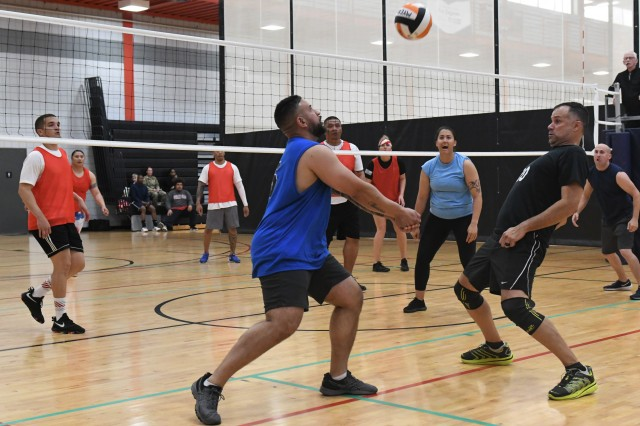 John Colondres keeps the volley going as teammates Ramon Rodriquez and Amber Smith look on during the 2019 Intramural Volleyball Double Elimination Championship Tournament.