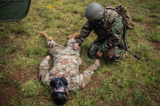 25th Infantry Division Soldiers test their knowledge of Chemical, Biological, Radiological and Nuclear (CBRN) at the CBRN lane ran by 25th Sustainment Brigade CBRN specialist during Day 1 of the 25th ID NCO/Soldier of the Year five day competition held 12-16 May 2019, Schofield Baracks, Hawaii. Soldiers have to react to chemical attack, perform first aid for nerve agent injury, identify chemical agents using an M256A1 Chemical Agent Detector kit and send up a CBRN 1 Report. (U.S. Army Photo by Sgt. Sarah D. Williams)