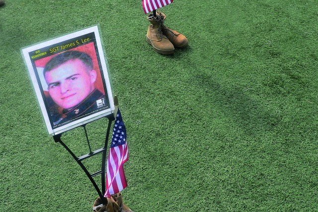 Boots displaying the pictures of fallen military members are displayed on field during the Run for the Fallen event May 11.