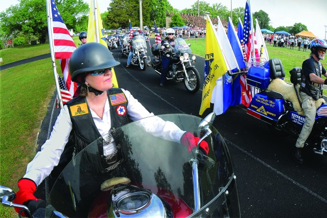 Members of the Patriot Guard Riders Motorcycle Club escort the marchers around the track during the ninth annual Run for the Fallen honor and remembrance event May 11 at Williams Stadium.