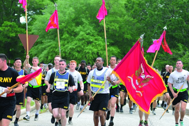 Ordnance School students and cadre run along Lee Avenue during the Run for the Fallen event May 11. Thousands of participants either ran or walked during the event serving to honor and remember military members who died in uniform.