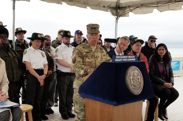 Lt. Gen. Todd Semonite, 54th USACE Chief of Engineers speaks at the podium at Rockaway Beach, N.Y. USACE placed 348,000 cubic yards of sand at the eroded beach.