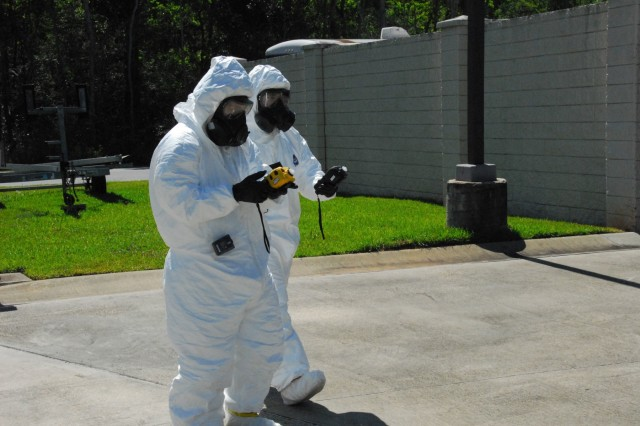 Soldiers from the 20th Chemical, Biological, Radiological, Nuclear, Explosives (CBRNE) Command in full protective gear check an area for nuclear fallout contamination during Prominent Hunt 19-1 in Mobile, Alabama. Prominent Hunt 19-1 is part of regularly scheduled biannual interagency training exercises by the U.S. government's National Technical Nuclear Forensics (NTNF) Ground Collection Task Force (GCTF) that have been conducted since 2012. This training exercise provides an opportunity to practice and enhance the NTNF GCTF's operational readiness to respond to a nuclear detonation in the United States or overseas. (U.S. Army photo by Clem Gaines)