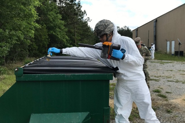 Spc. Larry Walker, from Atlanta, Georgia, uses a 2-inch paint brush to gather possibly contaminated debris and then vacuum it into a sample jar. Each sample jar is marked with the exact location where the debris was collected. Prominent Hunt 19-1 is part of regularly scheduled biannual interagency training exercises by the U.S. government's National Technical Nuclear Forensics (NTNF) Ground Collection Task Force (GCTF) that have been conducted since 2012. This training exercise provides an opportunity to practice and enhance the NTNF GCTF's operational readiness to respond to a nuclear detonation in the United States or overseas.