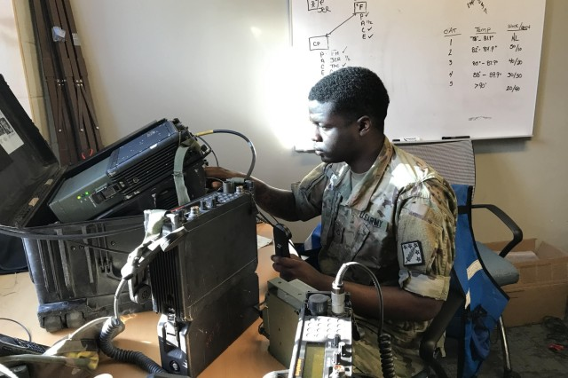 Pfc. Cameron Clayton, a signal support systems specialist from West Palm Beach, Florida, operates and monitors the satellite communications system that supports the downrange missions for Prominent Hunt 19-1. He was part of a four-person mobile communications team from the 20th Chemical, Biological, Radiological, Nuclear, Explosives (CBRNE) Command supporting Prominent Hunt 19-1. Prominent Hunt 19-1 is part of regularly scheduled biannual interagency training exercises by the U.S. government's National Technical Nuclear Forensics (NTNF) Ground Collection Task Force (GCTF) that have been conducted since 2012. This training exercise provides an opportunity to practice and enhance the NTNF GCTF's operational readiness to respond to a nuclear detonation in the United States or overseas.