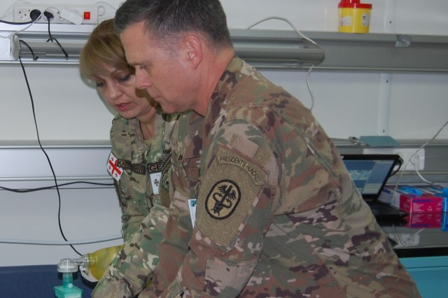 A German-military participant of the Regional Health Command Europe Spring Medical Surgical Training, takes part in hands-on training offered during the event. The hands-on operational training corresponded with the lectures. These trainings utilized high fidelity mannequins for cardio and pulmonary simulations, as well as procedure models for chest tubes and cricothyroidotomy.