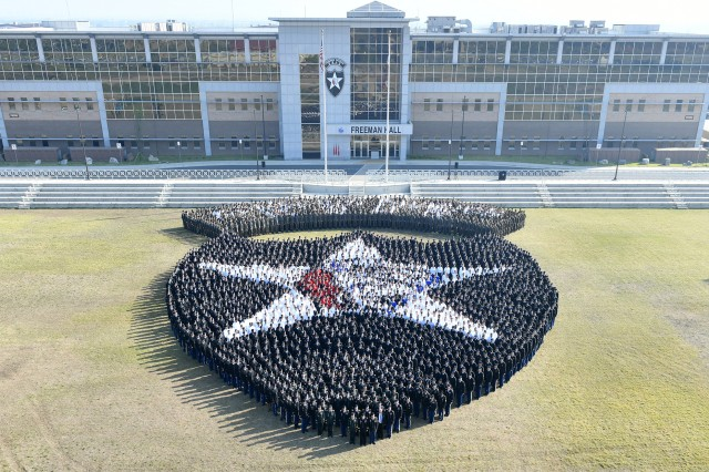 CAMP HUMPHREYS, Republic of Korea -- More than 3,500 2nd Infantry Division/ROK-U.S. Combined Division Warriors replicate a living Indianhead insignia in front of the division headquarters at Camp Humphreys, May 10. The 2ID/RUCD living insignia tradition began in 1925 and has been recreated four times in the division's history. (U.S. Army photo by Mr. Pak, Chin-U, 2nd Infantry Division/ROK-U.S. Combined Division Public Affairs Office)