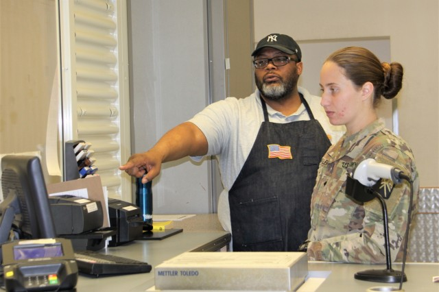 Maurice Williams, Baumholder Postal Service Center lead postal assistant, explains procedures to Spc. Krista Valero, 569th Human Resources Company. 569th HRC will support the center with a rotation of six Soldiers every five months. (U.S. Army photo by Bernd Mai)