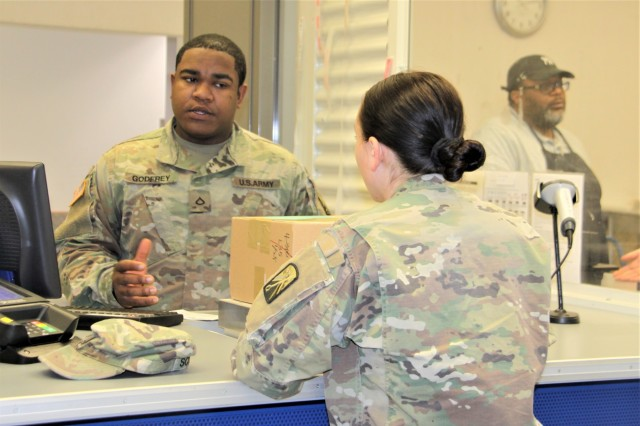 Pfc. Tahj Godfrey, 569th Human Resources Company, serves a customer at Baumholder Postal Service Center. 569th HRC will support the center with a rotation of six Soldiers every five months. (U.S. Army photo by Bernd Mai)
