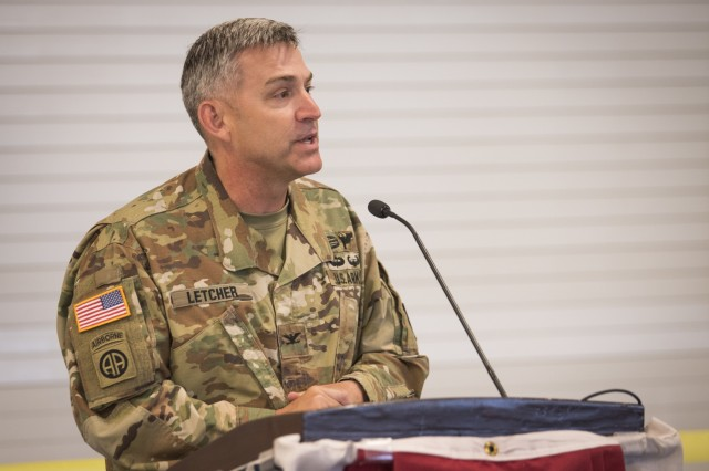 Col. Ken Letcher, commander, Rock Island Arsenal Joint Manufacturing and Technology Center, speaks at the ribbon cutting ceremony for the Advanced and Additive Manufacturing Center of Excellence at Rock Island Arsenal, Illinois, May 15. (U.S. Army photo by Kevin Fleming/Army Sustainment Command)