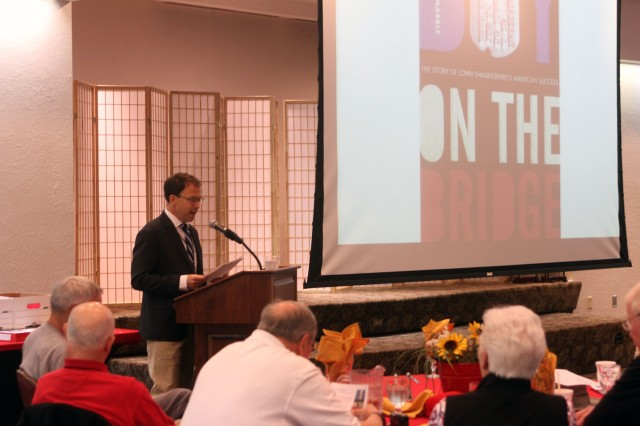 "Dr. Andrew Marble reads from ""The Boy on the Bridge,"" his biography of former Chairman of the Joint Chiefs of Staff Gen. John Shalikashvili, the highest-ranking graduate of Fort Sill's Field Artillery Officer Candidate School May 9, 2017, during a reunion of the FAOCS Alumni Association at Fort Sill, Okla."