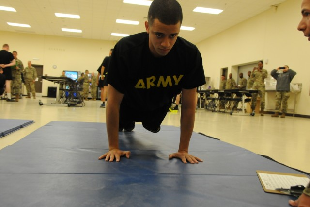Spc. Antonio Negron, assigned to 7246th Medical Support Unit located in Elkhorn, Nebraska, begins the push-up event for the Army Physical Fitness Test on April 14th.  Negron is one of fifteen Soldiers from Army Reserve Medical Command who arrived on April 13th, prepared to compete in the command-level Best Warrior Competition for 2019 held April 13-17 at Joint Base Lewis McChord, Washington. The Best Warrior Competition recognizes Soldiers who demonstrate commitment to the Army values, embody the Warrior Ethos and represent the force of the future.