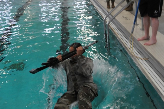 Staff Sgt. Giselle Pena, assigned to Headquarters and Headquarters Detachment of Army Reserve Medical Command located in Pinellas Park, Florida, competes in the combat water survival event on April 14th.  Pena is one of fifteen Soldiers from Army Reserve Medical Command who arrived on April 13th, prepared to compete in the command-level Best Warrior Competition for 2019 held April 13-17 at Joint Base Lewis McChord, Washington. The Best Warrior Competition recognizes Soldiers who demonstrate commitment to the Army values, embody the Warrior Ethos and represent the force of the future.