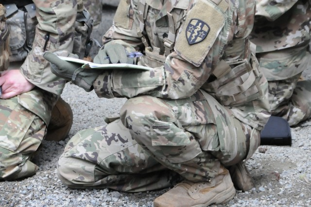 Sgt. Robert Strunk, assigned to 7388th Blood Det. in Fort Jackson, South Carolina, takes notes in preparation for the M-9 qualification event on April 14th.  Strunk is one of fifteen Soldiers from Army Reserve Medical Command who arrived on April 13th, prepared to compete in the command-level Best Warrior Competition for 2019 held April 13-17 at Joint Base Lewis McChord, Washington. The Best Warrior Competition recognizes Soldiers who demonstrate commitment to the Army values, embody the Warrior Ethos and represent the force of the future.