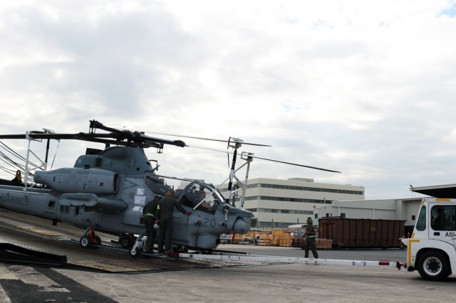 Marines offload a helicopter from the M/V Green Lake during discharge operations at Pearl Harbor on May 7.