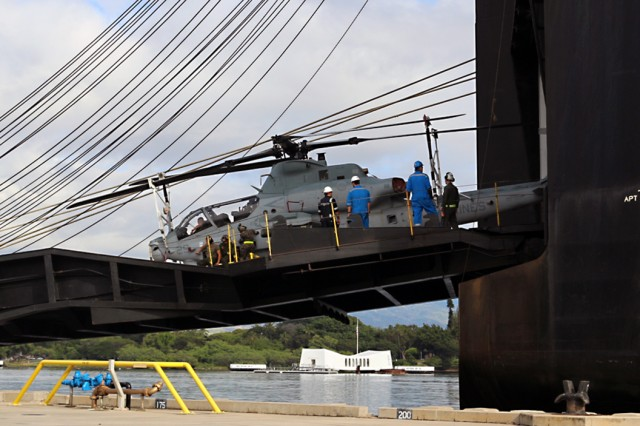 Marines offload a Cobra helicopter from the M/V Green Lake during discharge operations at Pearl Harbor on May 7.