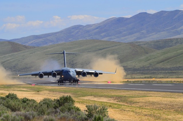 A 446th Airlift Wing C-17 Globemaster III aircrew lands for the first time at the Selah airstrip at the Yakima Training Center May 1.