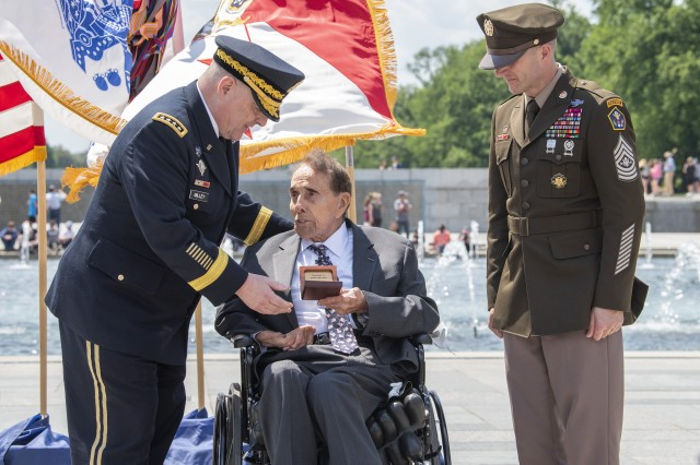 Army Chief of Staff Gen. Mark A. Milley, left, and Sgt. Maj. of the Army Daniel A. Dailey, right, present former Sen. Bob Dole a wooden box with colonel rank in it during a honorary promotion ceremony at the World War II Memorial in Washington, D.C., May 16, 2019. Dole was medically discharged as a captain after being severely wounded in WWII.