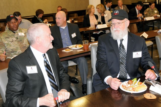 WQAD President and General Manager, Jim Kizer (left), sits down to a meal with First Army Deputy of Chief of Staff, Tommy Thompson, during the First Army community leaders luncheon on May 15 in the Pershing Conference Room of First Army headquarters on Rock Island Arsenal, Ill.
