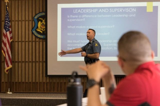 Lt. Joey Day of the Missouri State Highway Patrol briefs Military Police Soldiers from Fort Leonard Wood on elements of leadership in his own organization.