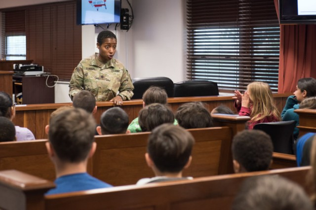 Lt. Col. Tanasha Stinson, deputy staff judge advocate, discusses the mock trial with the students.
