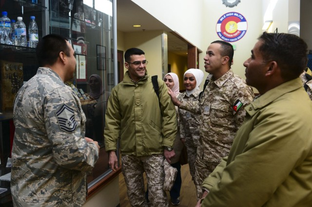 U.S. Air Force Senior Master Sgt. Jose Alfaro, 140th Wing Security Forces, Colorado Air National Guard, escort members of the Royal Jordanian Air Force on a tour of the Chief Warrant Officer 5 Dave Carter Army Aviation Support Facility at Buckley Air Force Base, Aurora, Colorado, Feb. 5, 2019. The meeting between Jordanians and senior enlisted leaders aimed to foster strong relationships between forces as well as enhance Jordanian enlisted policy and practices. Jordan and Colorado have been partners since 2004.