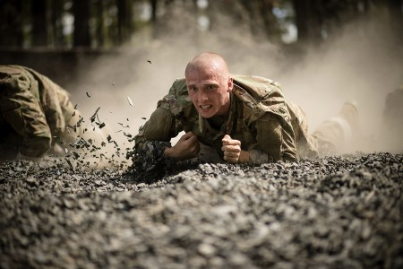"Trainees low crawl toward the finish line of the ""Fit To Win"" endurance course during week 2 of basic combat training at Fort Jackson, S.C. The installation trains 50 percent of the U.S. Army's basic combat training load and more than 60 percent of a..."