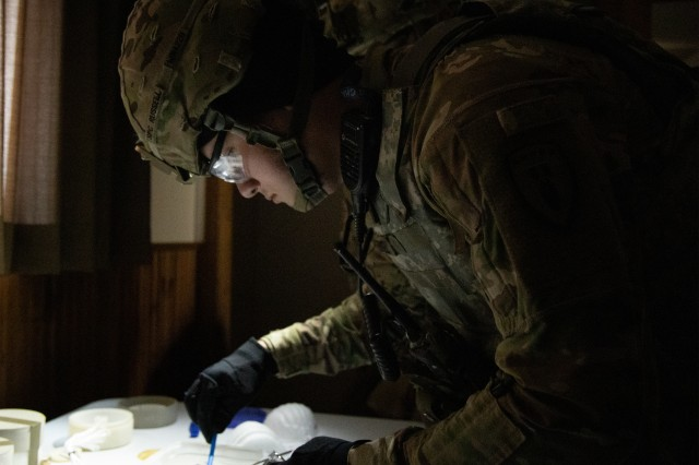 Spc. Wyatt Russell, 630th Ordnance Company (EOD), takes a sample of possible explosives for testing at Raven's Challenge, Winter Park, Colo. May 7, 2019. Raven's Challenge is an annual series of events that provide Explosive Ordnance Disposal personnel and Public Safety Bomb Squads of both military and government agencies interoperability in a realistic, domestic, tactical environment.