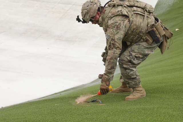 Staff Sgt. Daniel Lewis, a member of 764th Ordnance Company, 242nd Ordnance Battalion (EOD), marks location of explosive debris at Winter Park, Colorado, May 7, 2019. Raven's Challenge is an annual event that provides explosive ordnance disposal personnel and public safety bomb squads of both military and government agencies interoperability in a realistic, domestic, tactical training environment.