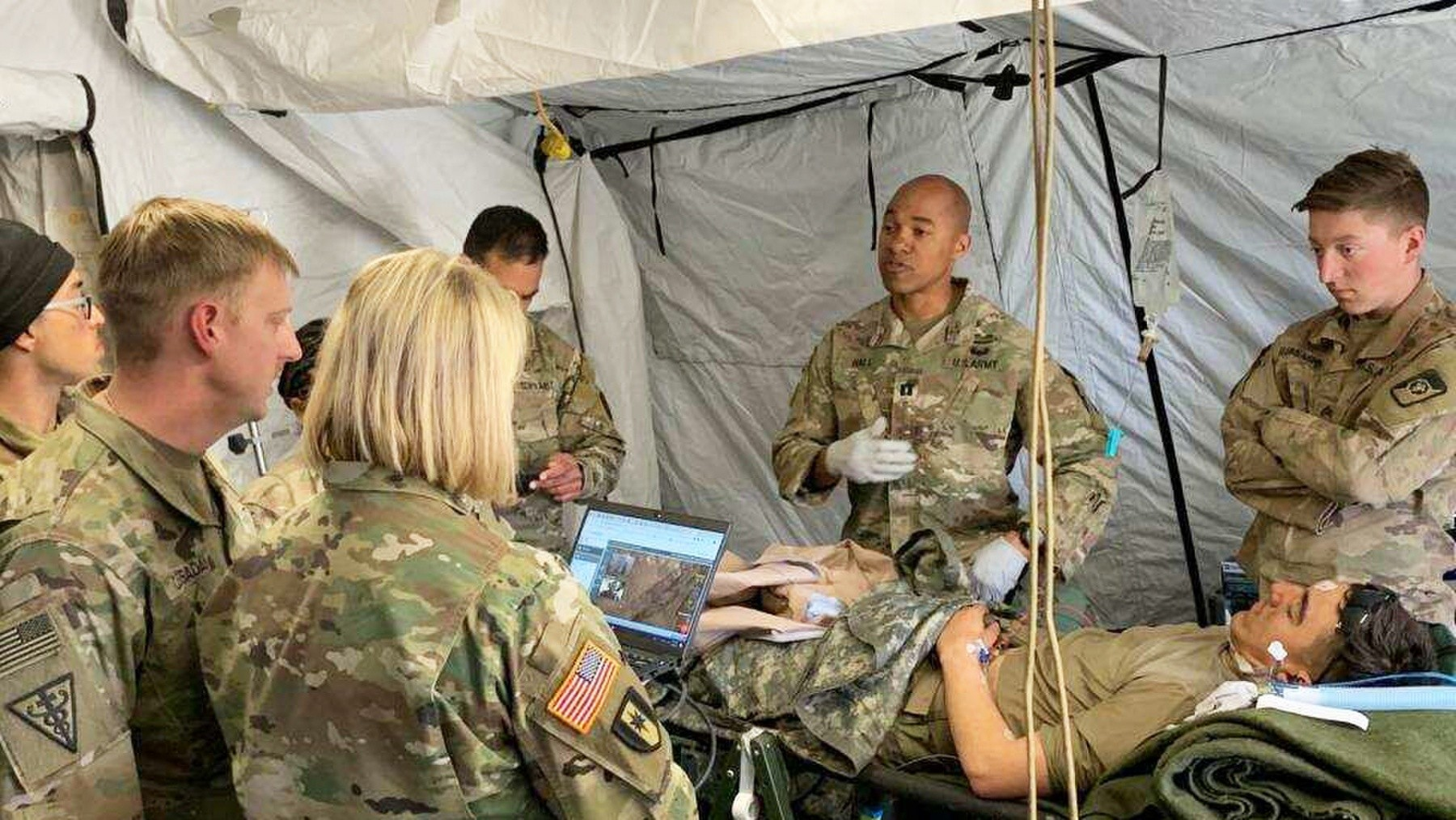 Medical personnel from Regional Health Command-Pacific, Madigan Army Medical Center, Telemedical Research for Operational Support, the 250th Forward Surgical Team and other medical assets utilize virtual health capabilities to treat a simulated patient during the recent Joint Warfighting Assessment April 23 to May 10 in Yakima, Washington. Regional Health Command-Pacific tested several virtual health capabilities during JWA 19. (Photo Credit: Courtesy Photo)