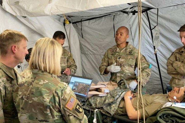 Medical personnel from Regional Health Command-Pacific, Madigan Army Medical Center, Telemedical Research for Operational Support, the 250th Forward Surgical Team and other medical assets utilize virtual health capabilities to treat a simulated patient during the recent Joint Warfighting Assessment April 23 to May 10 in Yakima, Washington. Regional Health Command-Pacific tested several virtual health capabilities during JWA 19.