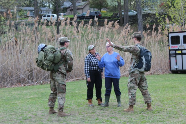 Cadets talk with actors playing locals during West Point Irregular Warfare Group's Unconventional Warfare Exercise that took place April 23-26.