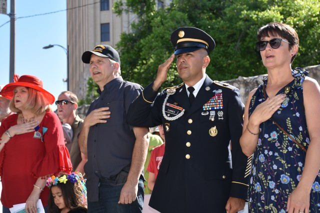 Command Sgt. Maj. Marco Torres and his wife, Carmelita, render honors during Fiesta San Antonio's San Jacinto Victory Celebration April 19, 2019, at the Alamo Cenotaph in San Antonio. Fiesta is a 10-day celebration honoring the city's rich military history.