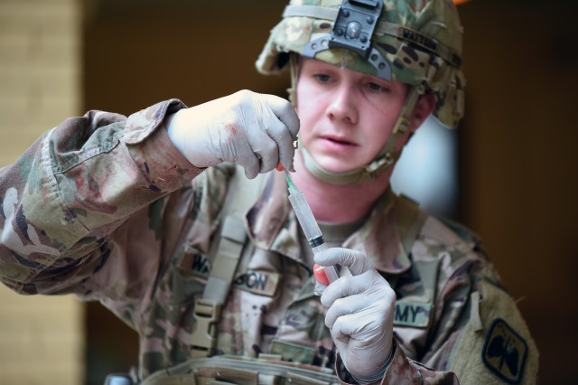 A 68W Combat Medic attending the AMEDDC&S HRCoE Noncommissioned Officers Academy Advanced Leader Course preparing an injection.