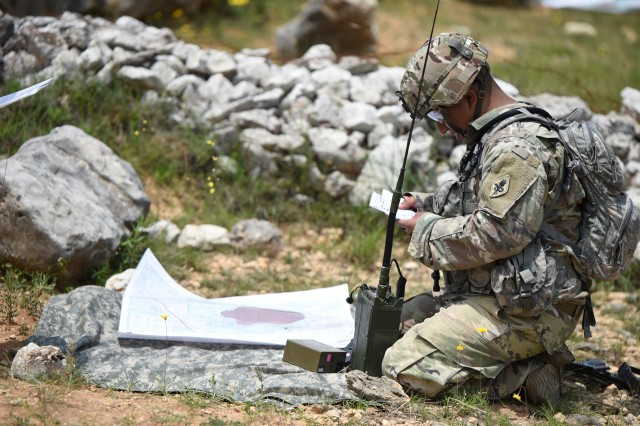 A Soldier assigned to the Training Support Activity, AMEDDC&S HRCoE, training at Camp Bullis, Tex, reviews a 9 Line MEDEVAC request before calling it in over a radio.