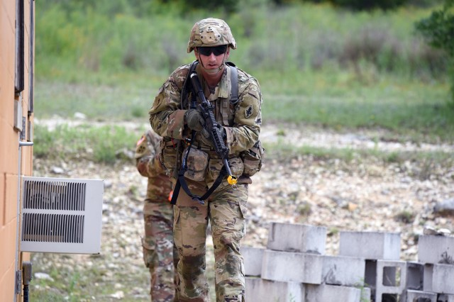A Soldier assigned to the Medical Professional Training Brigade, practicing Warrior Task and Battle Drills at Camp Bullis, Tex.