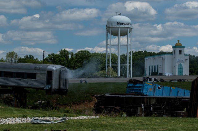 A train sits derailed as Soldiers participate in Vibrant Response 19 at Muscatatuck Urban Training Center, Indiana, May 15, 2019. The annual exercise validates the Army's response to a catastrophic chemical, biological, radiological, nuclear and explosive attack on American soil. (U.S. Army photo by Daniel J. Alkana/22 Mobile Public Affairs Detachment)