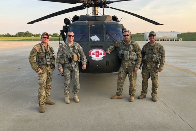 Staff Sgt. Jeremy Lowe, Chief Warrant Officer Cliff Flanagan, Capt. Jonathan Strayer, Staff Sgt. Shaun Morris, left to right, with Charlie Company, 2nd battalion, 238th Aviation responded to a request for assistance from Wolfe County Emergency Management for a hoist rescue near Slade, Ky., May 18, 2019. The Guardsmen conducted a medical evacuation of a patient from a cliff in Natural Bridge State Park. (Courtesy photo)