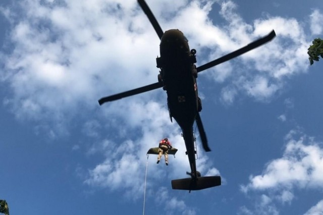 Staff Sgt. Jeremy Lowe with Charlie Company,  2nd Battalion, 238th Aviation conducts a medical evacuation near Slade, Ky., May 18, 2019. The MEDEVAC helicopter transported the patient to Lexington, Ky., where civilian EMS was waiting. (Photo courtesy of Wolfe County Search and Rescue)
