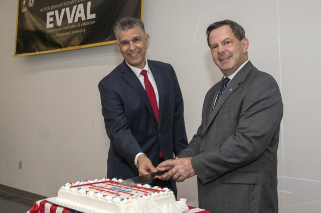 PICATINNY ARSENAL, N.J. - The new Experimental Verification and Validation Assessment Laboratory was officially opened on April 26. The new lab will help provide critical human research that supports armaments development. Pictured above, Anthony Sebasto, Executive Director for the Enterprise and Systems Integration Center, and John Finno, Director for Quality Engineering and System Assurance, cut the grand opening cake.